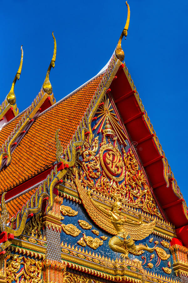 Traditional Thai temple front details. Wat Mongkol Nimit temple in Phuket town, southern Thailand stock photography