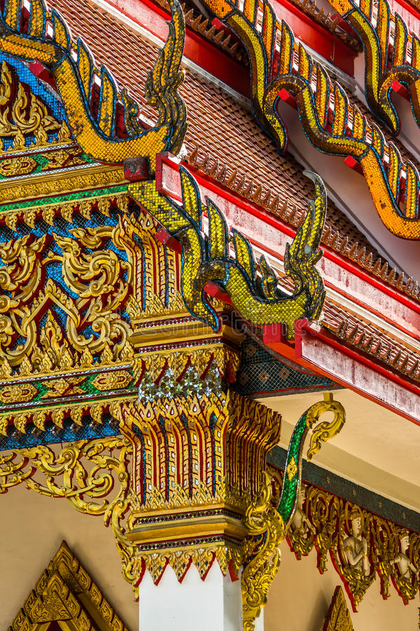 Traditional Thai temple front details. Wat Mongkol Nimit temple in Phuket town, southern Thailand royalty free stock photography