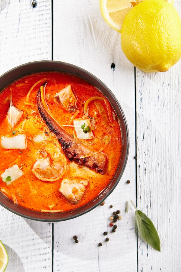 Traditional Thai Tom Yam Kung Soup. Restaurant Soup Food - Traditional Thai Tom Yam Kung Soup or Tom Yum Kong. Tom Yam is a Spicy Soup with Shrimp and Octopous stock image