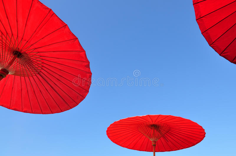Traditional Thai umbrella. With blue sky background royalty free stock photos