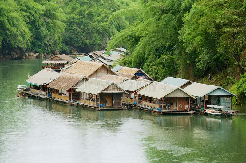 Traditional thai village with floating houses at the river bank in Suphan Buri, Thailand. royalty free stock image