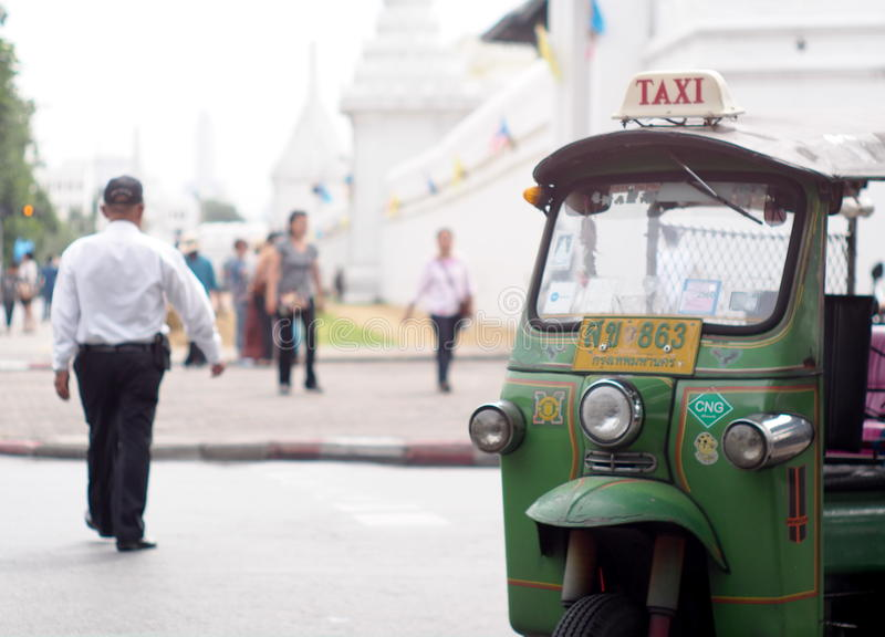 Traditional three-wheels THAI open air fun and well known BANGKOK and urban taxi royalty free stock images