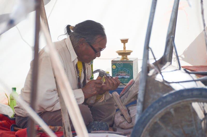 Traditional Tibetan engraver royalty free stock photography