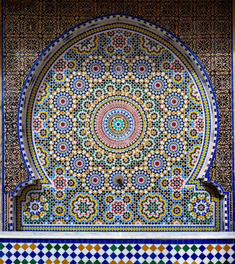 Traditional oriental tiles decorating the fountain, Morocco royalty free stock photo
