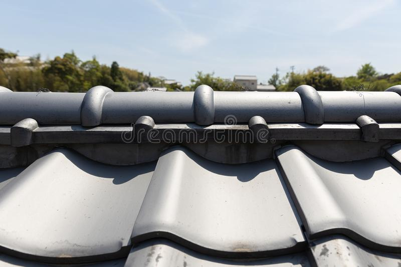 Traditional tiles rooftop of historic Japan house with Japanese style royalty free stock photos
