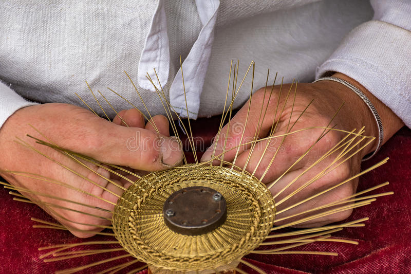 Traditional tinker Drotar making a bowl from wire stock photo