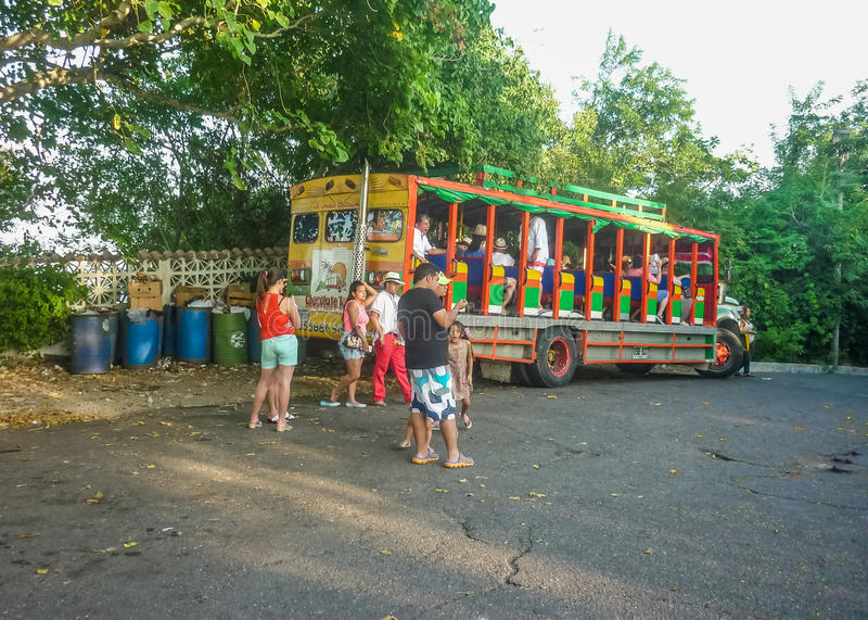 Traditional Tourist Bus in Cartagena Colombia. CARTAGENA, COLOMBIA, JANUARY - 2015 - People waiting to return from the visit of de la popa monastery located at stock photography