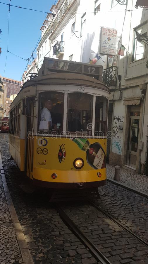 Traditional old tram in Lisbon streets stock photography