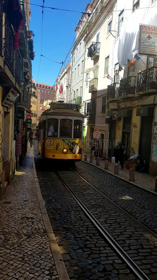 Traditional old tram in Lisbon streets royalty free stock image