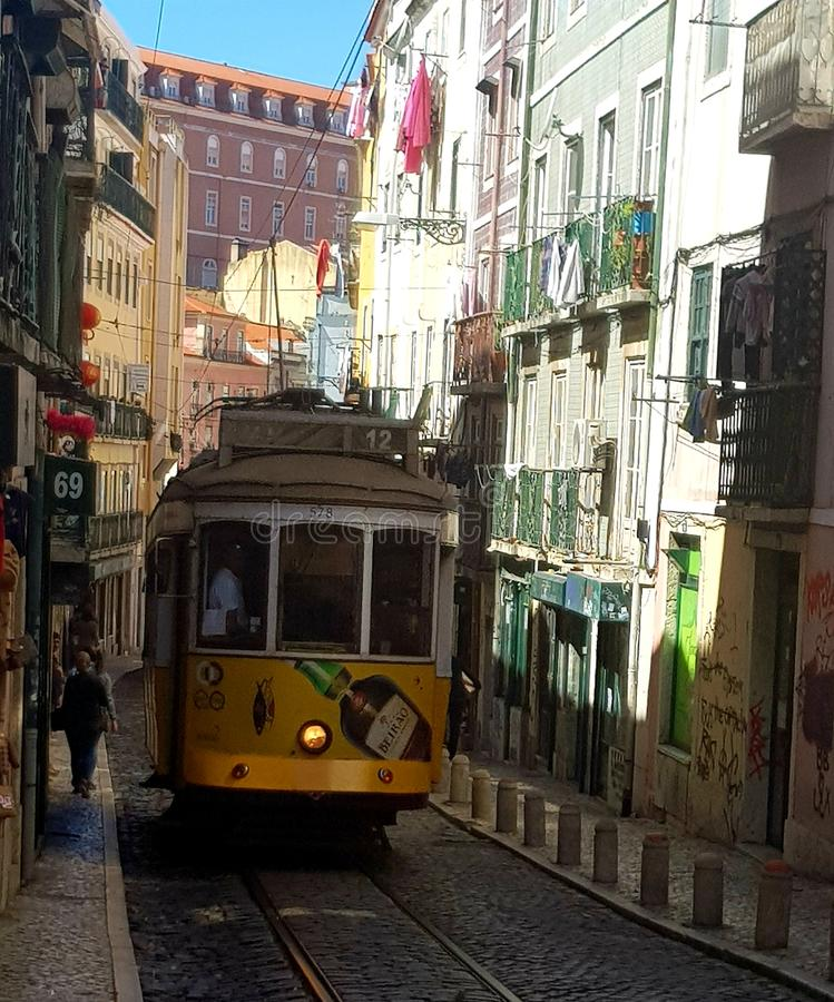 Traditional old tram in Lisbon streets stock images