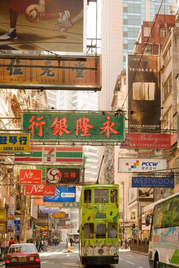 Traditional tram and store signs in a street view stock photography