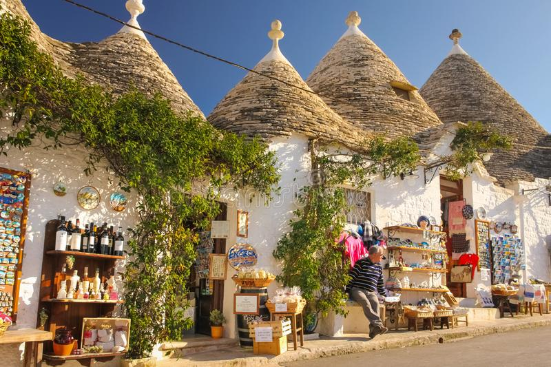 Traditional Trulli. Alberobello. Apulia. Italy. Picturesque street. Typical trulli with conical roof and flowerpots. Alberobello. Apulia. Italy royalty free stock photos