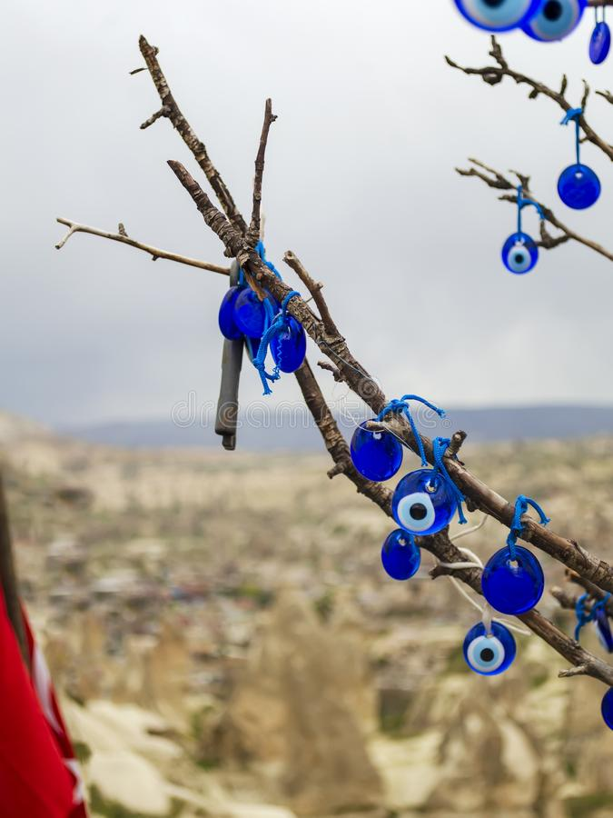 Traditional Turkish amulets - Nazar boncuk or Fatima Eye hang on the branches of a wishes tree. Many traditional Turkish amulets - Nazar boncuk or Fatima Eye royalty free stock image