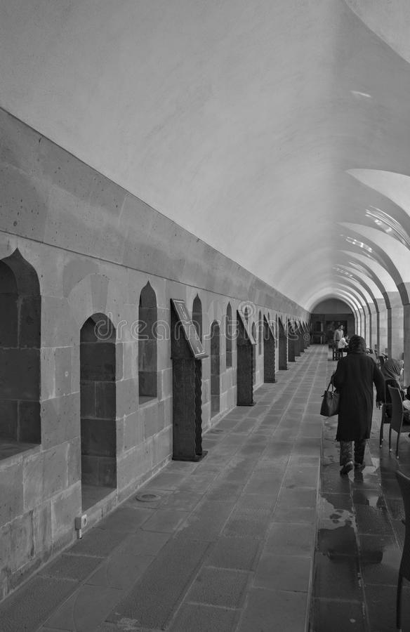Greyscale Traditional Stone Arch Walkway occupied by Turkish Locals royalty free stock photos