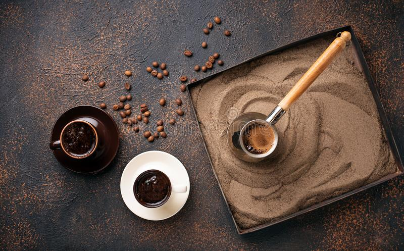 Traditional turkish coffee prepared on hot sand. Traditional turkish coffee in cezve prepared on hot sand. Selective focus stock photography