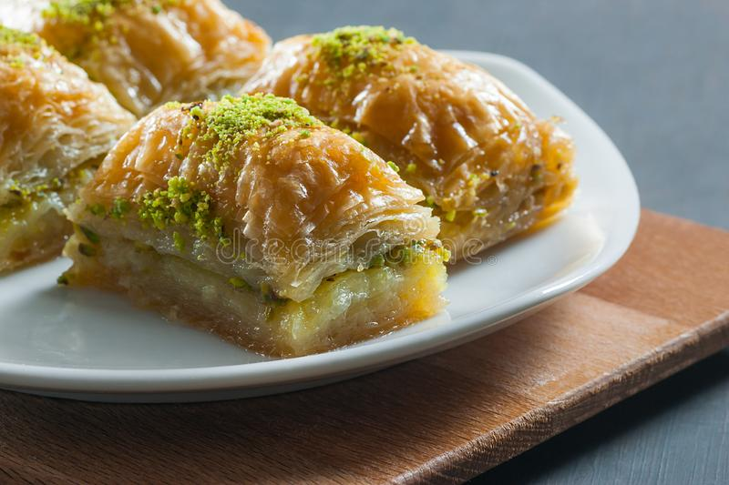 Traditional turkish dessert antep baklava with pistachio on white plate. Desserts concept stock photo