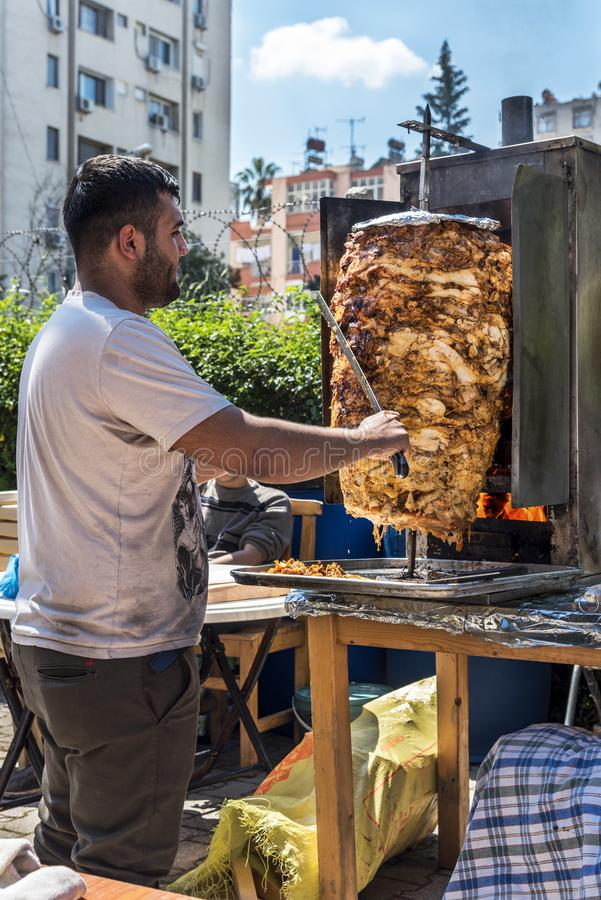 Traditional Turkish doner kebab prepared with chicken in Orange Blossom Carnival in Adana-Turkey royalty free stock image