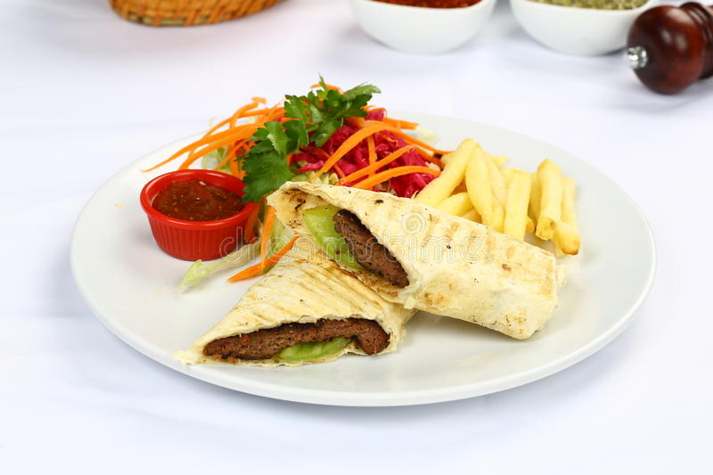 Traditional Turkish Durum, Wrap. Traditional turkish doner kebab in lavash bread served royalty free stock photos