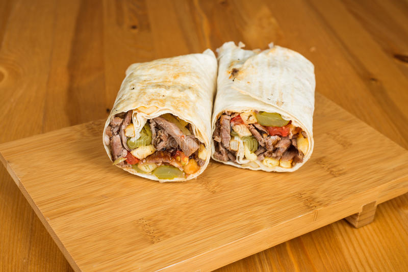 Traditional Turkish Durum, Wrap. Turkish Shawarma durum Traditional sish kebab wrap stock image