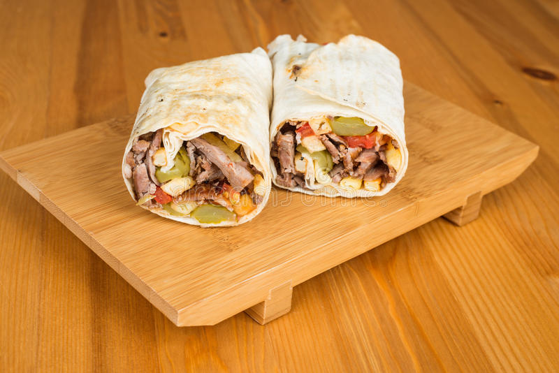 Traditional Turkish Durum, Wrap. Turkish Shawarma durum Traditional sish kebab wrap royalty free stock photos