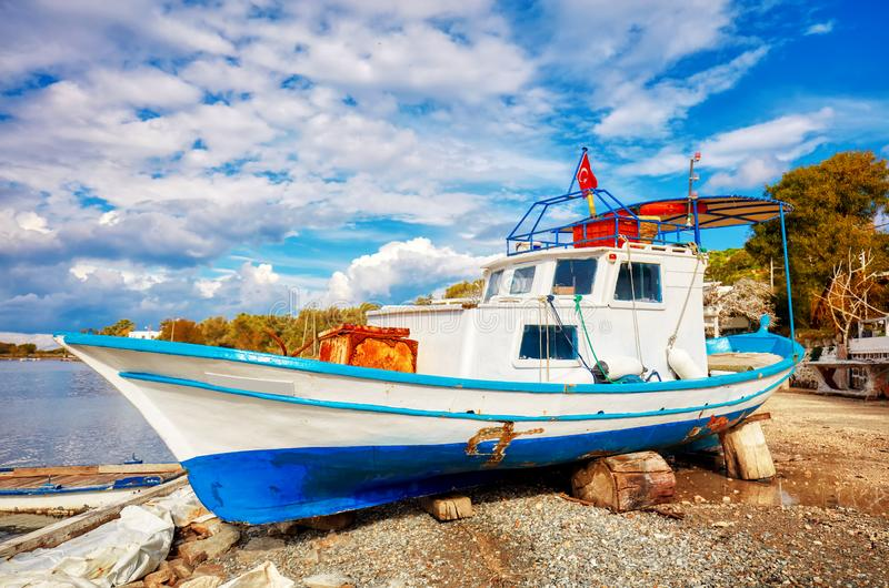 Traditional Turkish fishing boat ashore for maintenance royalty free stock photos