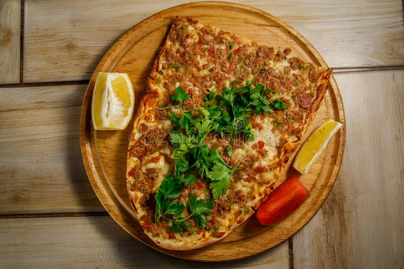 Traditional Turkish food Lahmajun on a wooden tray. stock images