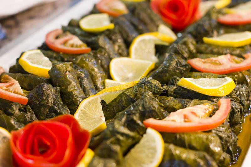 Traditional Turkish food - sarma in grape leaves stock photos