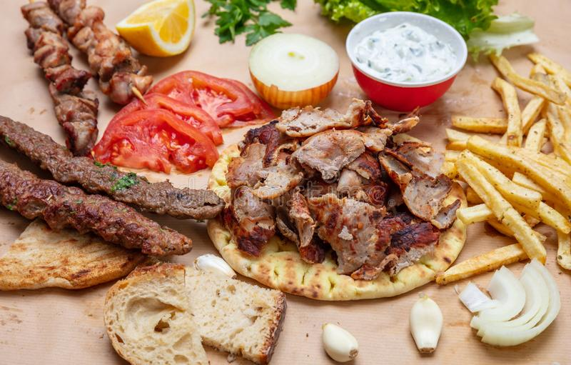 Traditional turkish, greek meat food. Shawarma, gyros, kebab, souvlaki and tzatziki on pita bread stock image