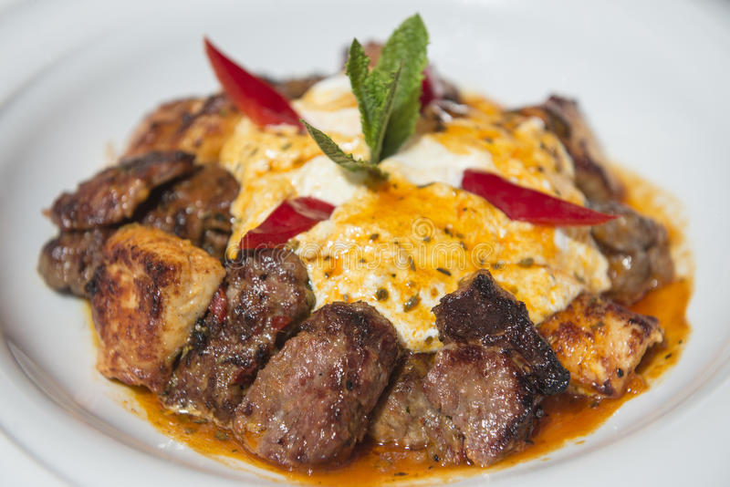 Traditional Turkish Iskender kebap served with tomato sauce and yogurt stock photos