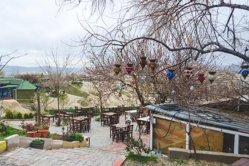 Traditional Turkish multicolored lamps on the branches of a tree. Early spring, preparation for the tourist season in Cappadocia. Traditional Turkish stock images