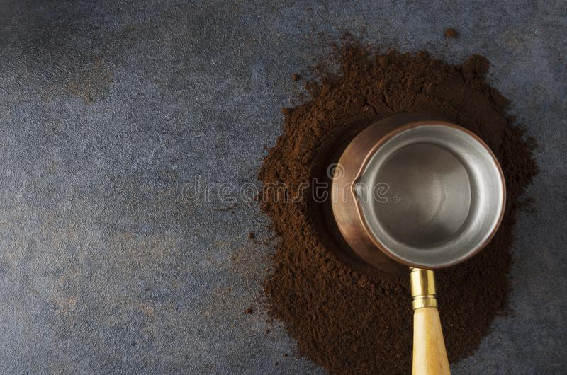 Top view of pile coffee, special coffee pot on dark table in the kithcen. Traditional turkish receipe of preparing tasty coffee with cezve and ground coffee stock images