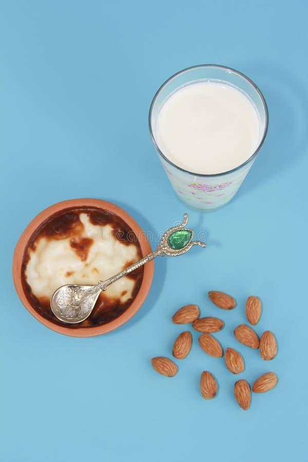 Traditional Turkish sweet supangle dish, a glass of airan and almonds. Traditional Turkish sweet supangle dish, glass of airan and almonds stock photography