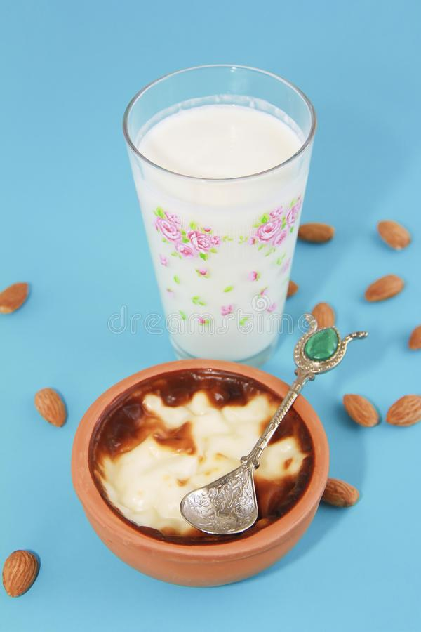 Traditional Turkish sweet supangle dish, a glass of airan and almonds. Traditional Turkish sweet supangle dish, glass of airan and almonds stock photos
