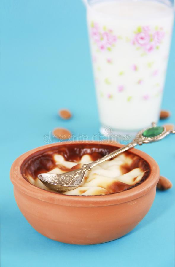 Traditional Turkish sweet supangle dish, a glass of airan and almonds. Traditional Turkish sweet supangle dish, glass of airan and almonds stock images
