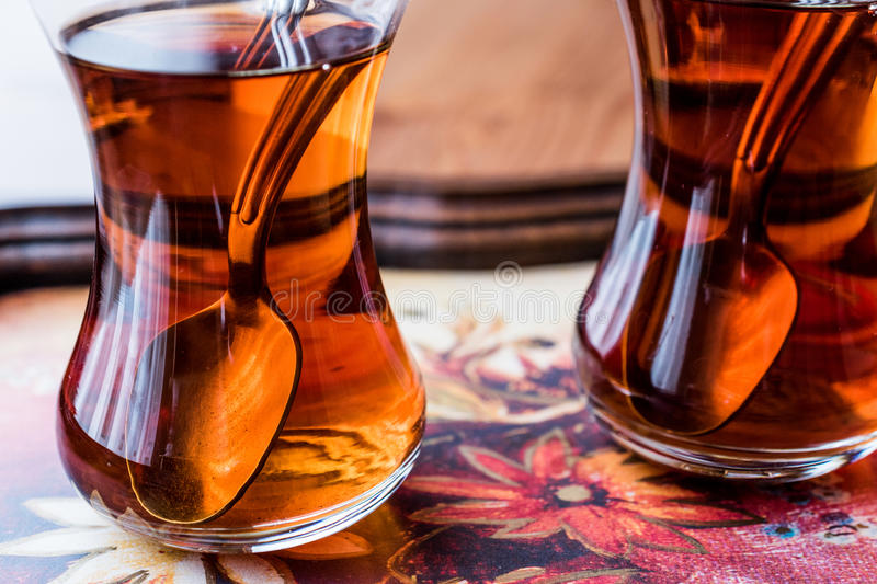 Traditional Turkish tea with spoon on wooden surface. Turkish drink royalty free stock photo