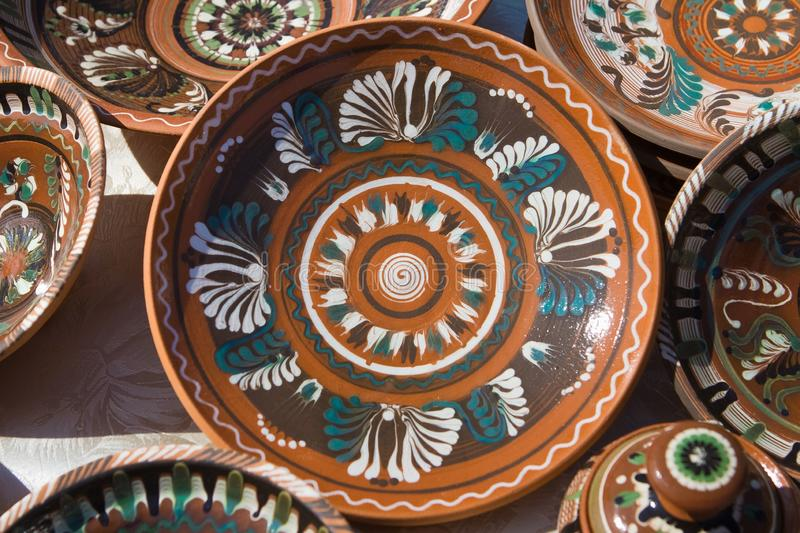 Traditional Ukrainian ceramic clay plates, handmade and handpainted. Bright floral and abstract pattern royalty free stock images