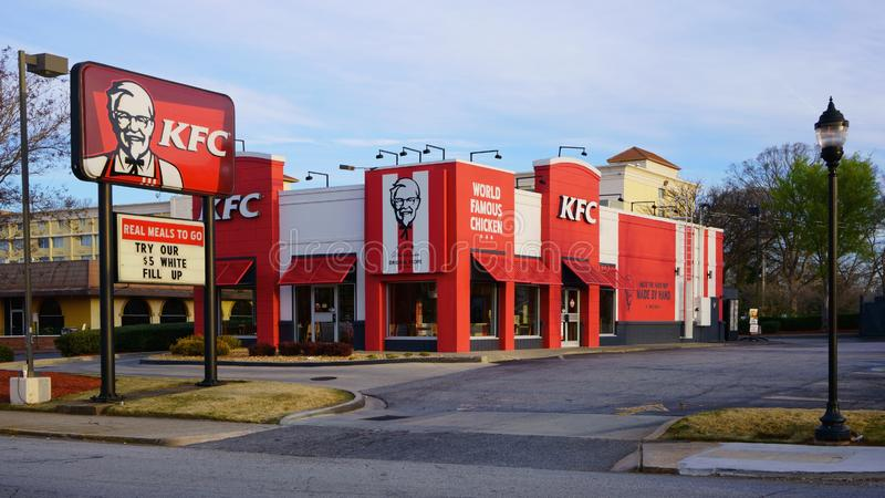 ATLANTA, GEORGIA, USA - MARCH 19, 2019: Exterior of KFC Kentucky Fried Chicken fast food restaurant with drive thru. Traditional US American restaurant chain royalty free stock photo