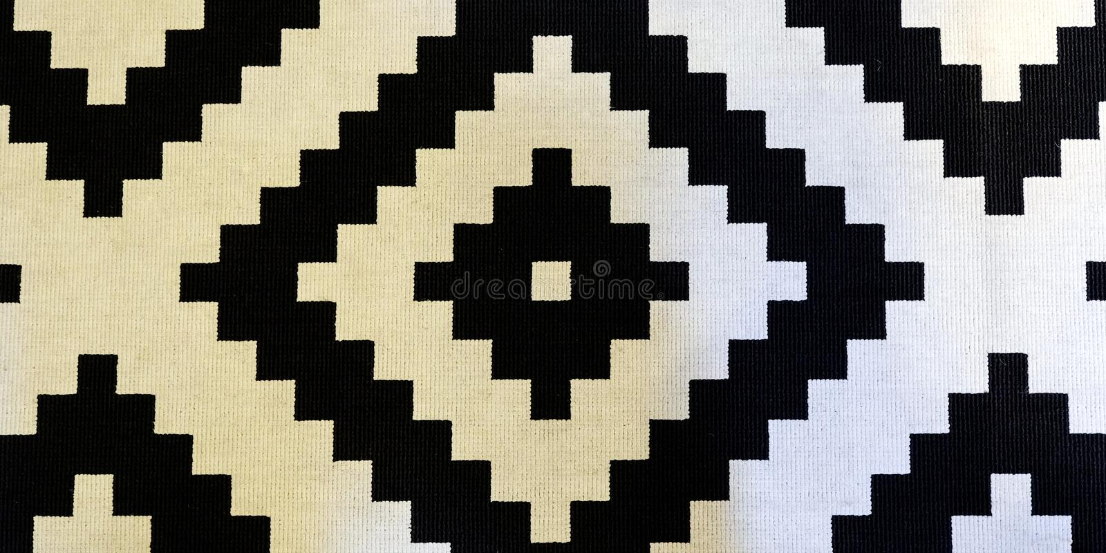 Traditional Uzbek pattern on a thick linen rug for the floor in the hallway stock photography