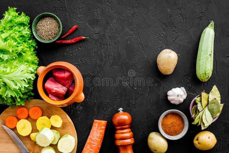Traditional vegetable dish cooked in oven on black background top view mock up stock photography