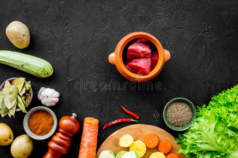 Traditional vegetable dish cooked in oven on black background top view stock photo
