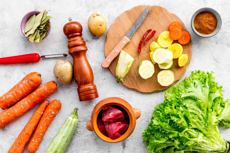 Traditional vegetable dish cooked in oven on stone background top view stock photography