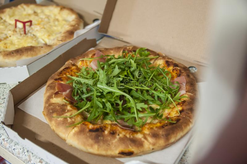 Traditional vegetarian pizza in cardboard box royalty free stock photography