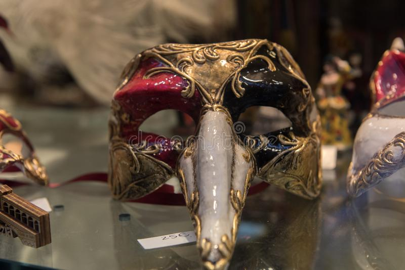 Traditional venetian mask in store on street, Venice Italy stock photo