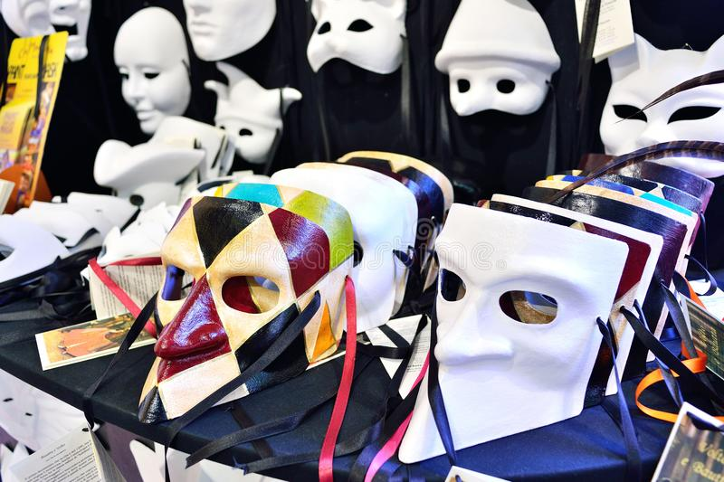 Traditional venetian mask in store on street, Venice Italy. stock images