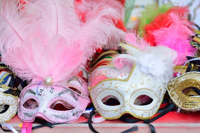 Traditional venetian mask in store on street, Verona Italy. royalty free stock image