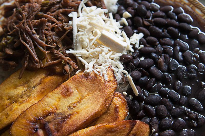Pabellón Criollo traditional venezuelan dish. Traditional Venezuelan dish Pabellon Criollo. White rice,Shredded Beef, Black beans, Fried Plantains. Lunch time royalty free stock photo