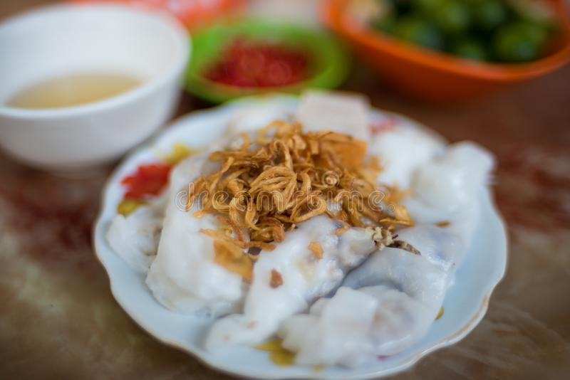 Traditional Vietnamese Banh Coun street food meal. Of rice stuffed pancakes decorated with shallot. Asian street food background stock photography