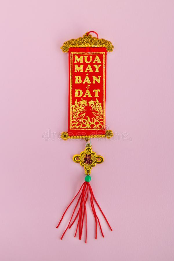 Traditional Vietnamese and Chinese New Year decoration red and golden colors on a pink background. stock photography
