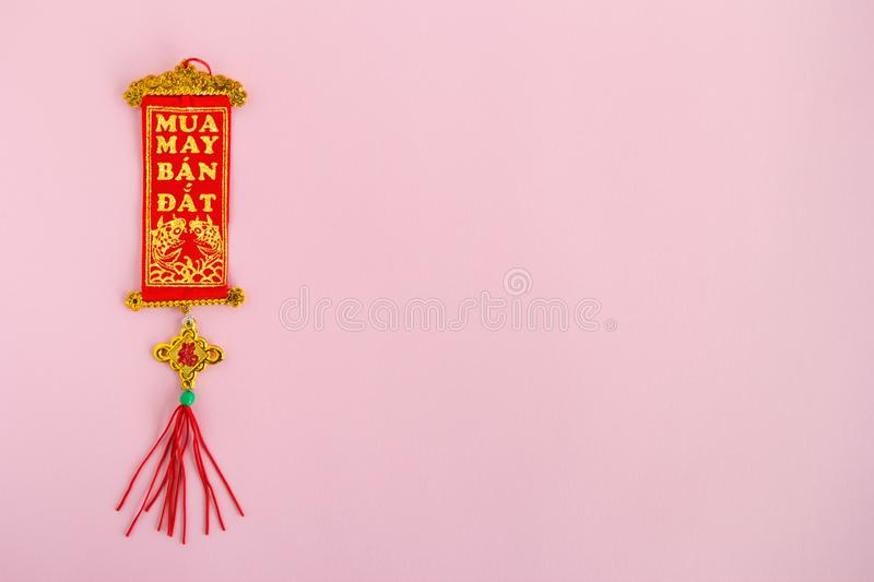 Traditional Vietnamese and Chinese New Year decoration red and golden colors on a pink background. royalty free stock photo