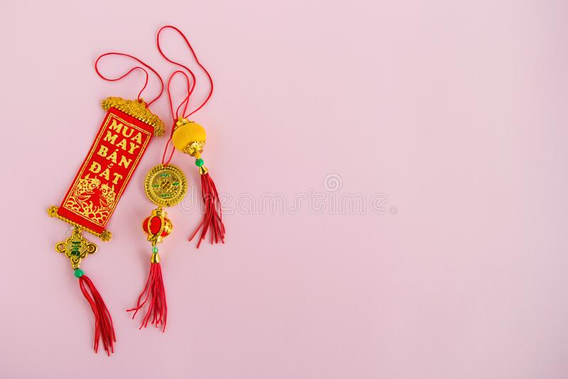 Traditional Vietnamese and Chinese New Year decorations red and golden colors on a pink background. royalty free stock photos